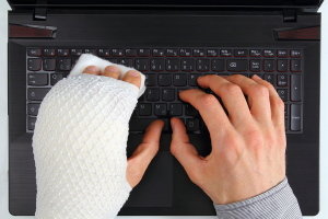 FMLA claim Employee typing with broken hand