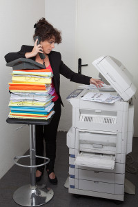 business woman copying employer's confidential documents