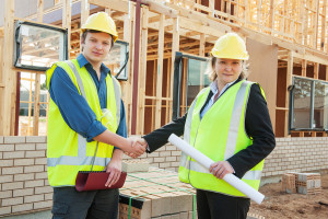 Construction workers reach handshake employment agreement