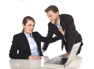 Woman being sexually harassed by boss