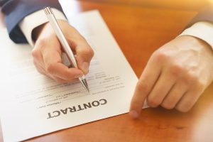 Lawyer signing employment agreement